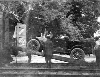 Car being loaded onto a train at De Leon Springs for a trip to Buffalo, New York (1912)