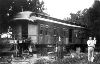 Family using a railroad car of the Tavares & Gulf Railroad as a home: Tavares, Florida (ca. 191-)