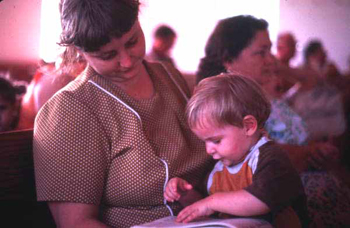 Mother and son with a Sacred Harp book at the Bethlehem Primitive Baptist Church: Old Chicora, Florida  (not after 1979)