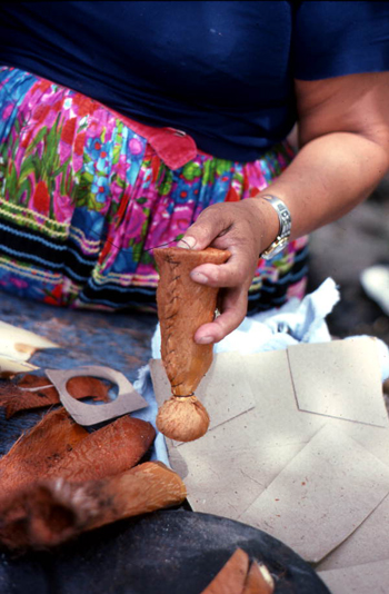 Mary Billie sewing on the bottom of the Seminole doll she is making: Big Cypress Seminole Indian Reservation, Florida (not after 1980)