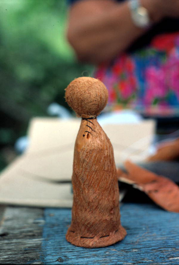 Seminole doll in the process of being made by Mary Billie: Big Cypress Seminole Indian Reservation, Florida (not after 1980)