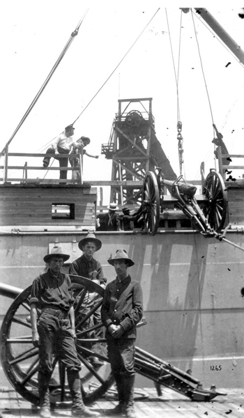 Cannons being loaded on transport preparing to sail to Cuba for the Spanish-American war: Tampa, Florida