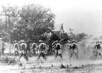 Company B of the 21st Infantry on a dusty march during the Spanish-American war(1898)