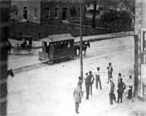 Horse-drawn trolley passing in front of the Marion County courthouse