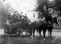 Firemen Aboard the First Hose Wagon in 1905 Then