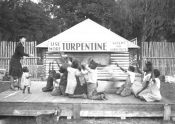 Woman and children on stage at turpentine plant in Brooksville, Florida (19--)