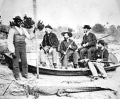 Stereoview of alligator hunting party
