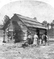 African American family and their log cabin