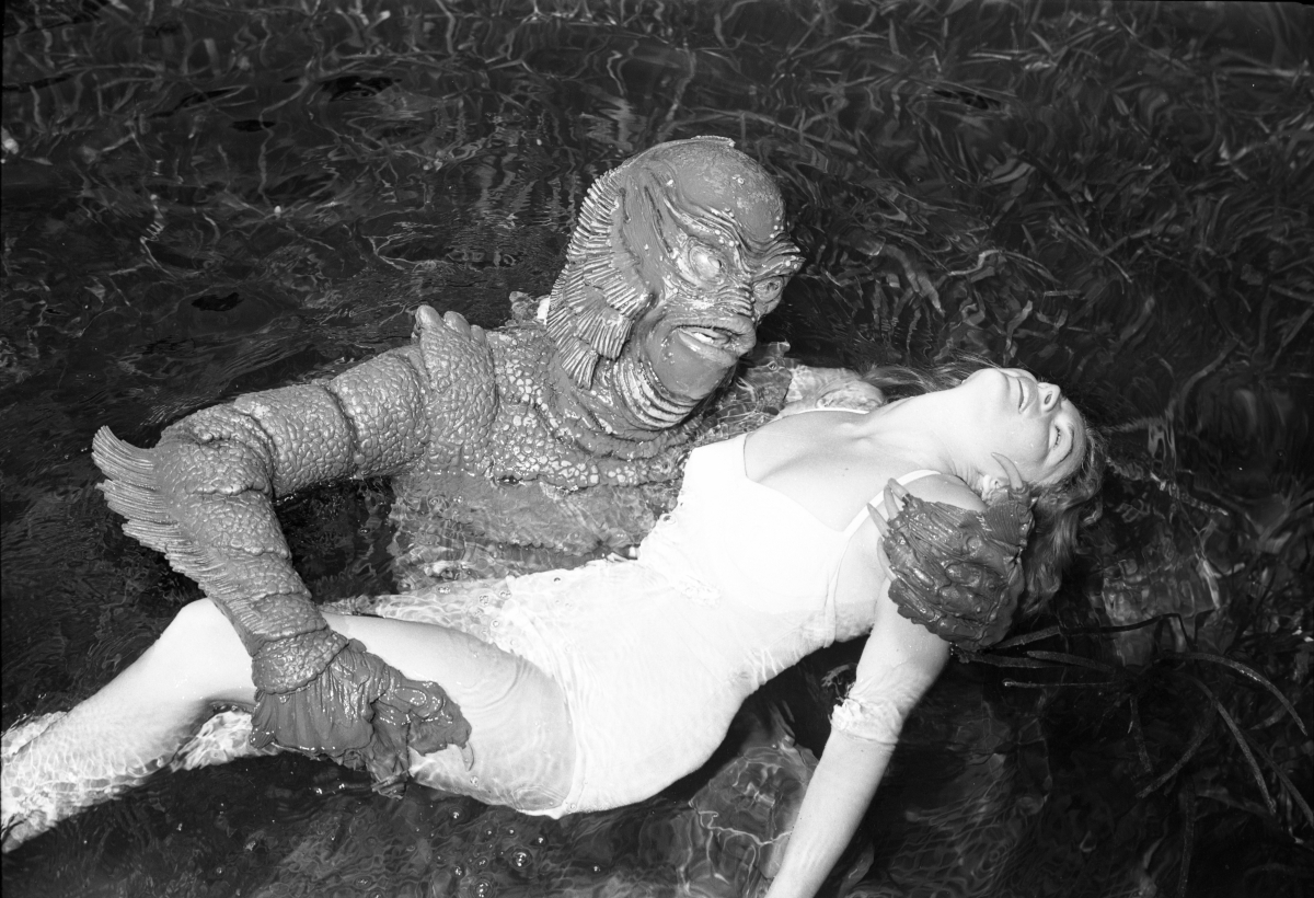 Ginger Stanley in the grip of the Gill-Man for promo still at Silver Springs.