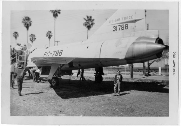Tommy Thompson standing next to jet plane at the Florida State Fair during Gasparilla in Tampa.