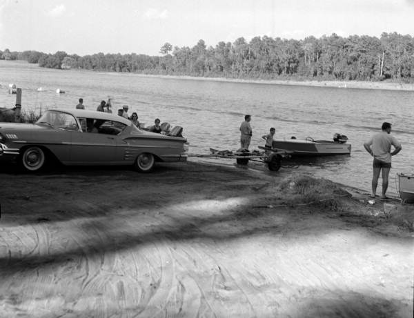 Swimmers and boaters in Lake Hall on Labor Day at Killearn (Maclay) Gardens State Park - Tallahassee, Florida.