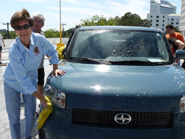 State Chief Financial Officer (CFO) Alex Sink washing a Toyota Scion car for State Employee Appreciation Day in Tallahassee, Florida.