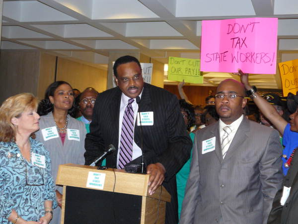 State Senator Al Lawson speaking at the state capitol during a news conference to protest the state budget proposal seeking to reduce state employee salaries.