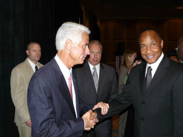 Governor Charlie Crist greeting former pro football star Lynn Swann of the Pittsburgh Steelers at the Rosen Shingle Creek Hotel in Orlando, Florida.
