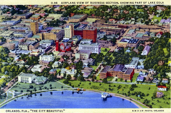 Aerial view of business section, showing part of Lake Eola.