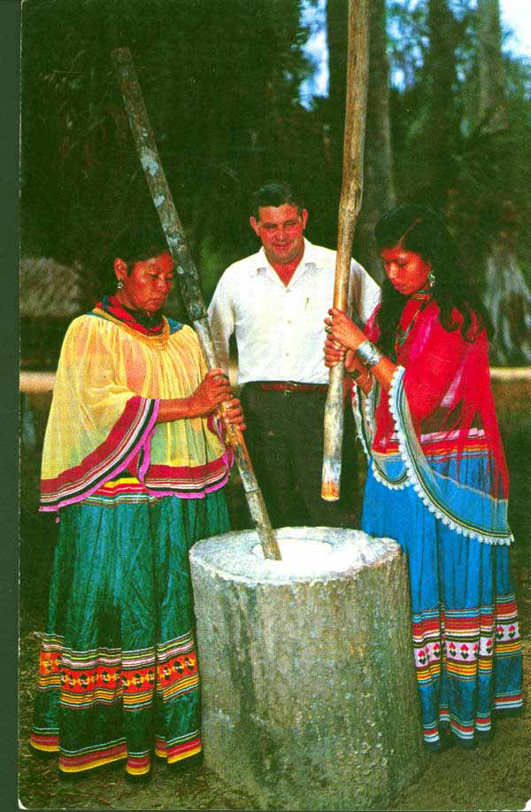 Seminole Indian women grinding corn - Silver Springs, Florida.