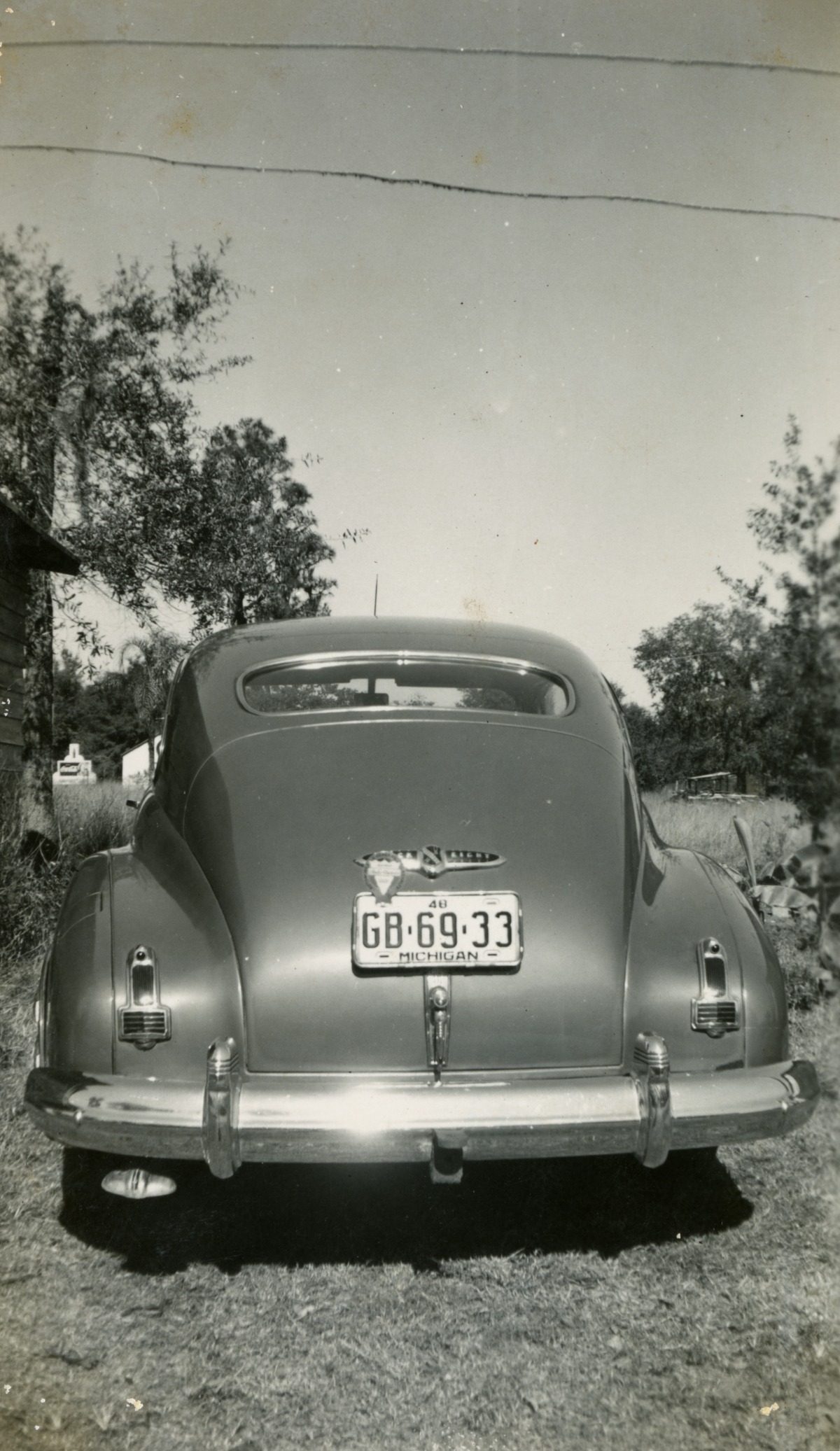 Rear of 1947 Buick eight special sedanette shown during Central Florida vacation of the Hall family from Michigan.