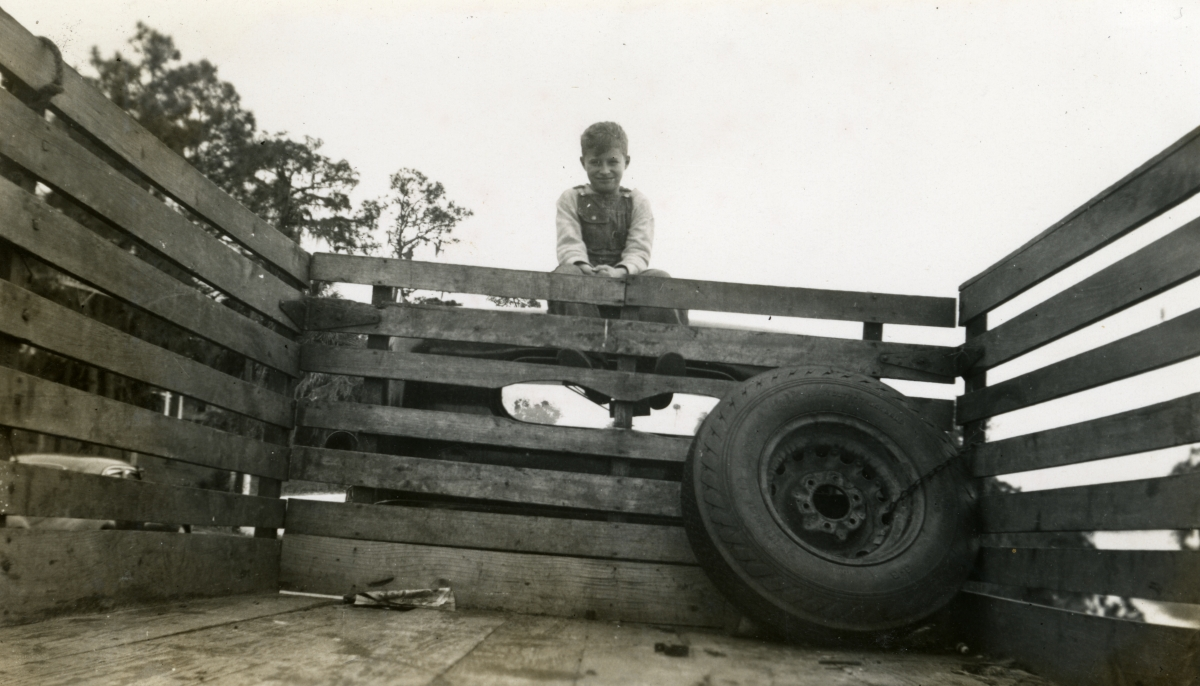 Hall family member from Michigan sitting on a truck during Central Florida vacation.