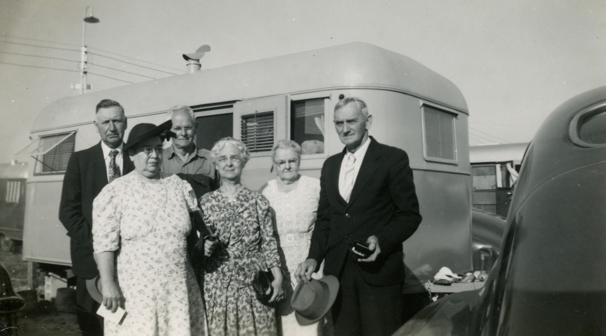 Hall family from Michigan shown with their trailer coach during Central Florida vacation.