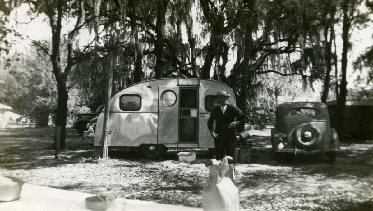 Hall family member from Michigan shown with his teardrop trailer during Central Florida vacation.