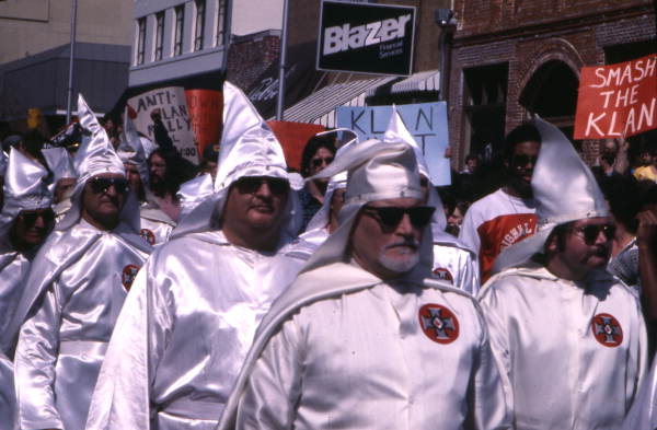 Close-up view showing KKK members during their downtown rally in Tallahassee, Florida.