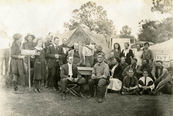 Visitors posing together in camp as a kangaroo court at Gainesville, Florida.