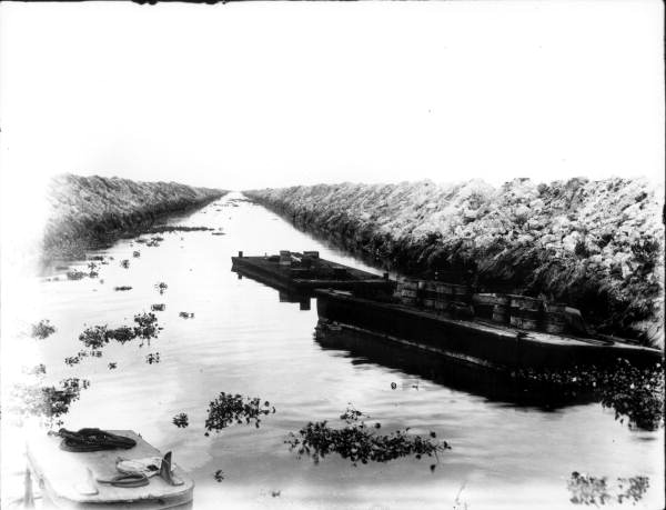 Flat boats in an Everglades Drainage District canal.