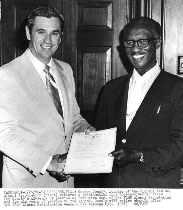 Governor Askew presenting an award to George Conoly of Florida A & M University - Tallahassee, Florida.