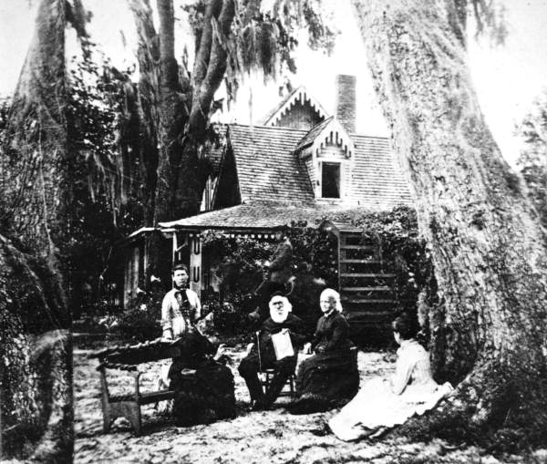Stowe family in front of their home.