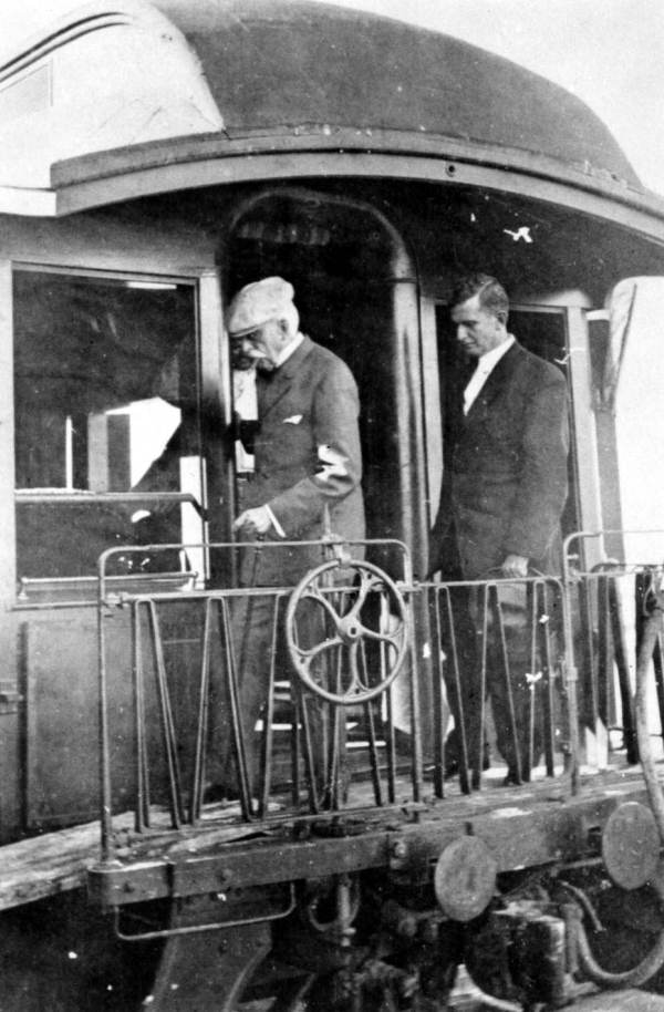 Henry Flagler disembarking train at Key West.