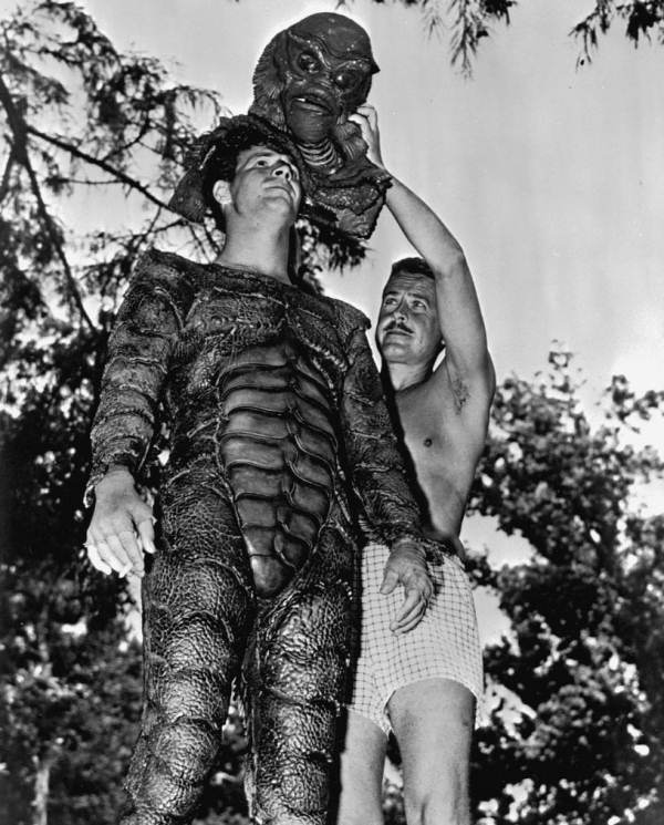 Ricou Browning is helped with his movie costume.