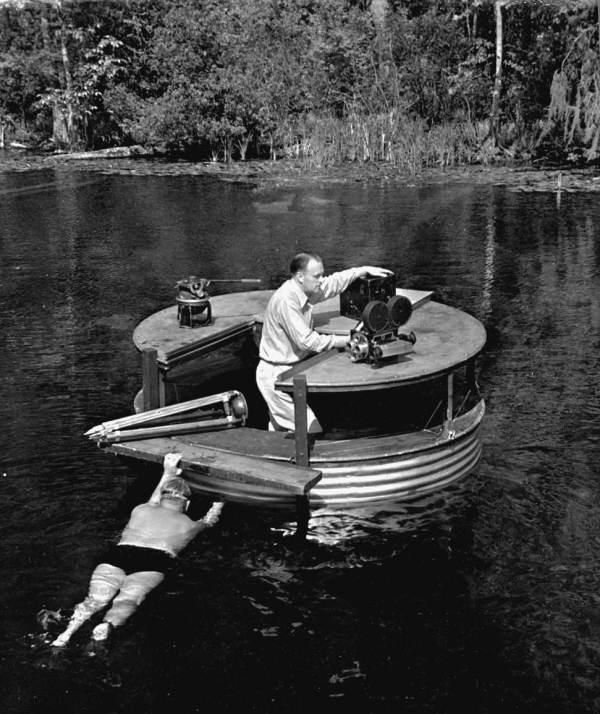Newton Perry propelling cameraman Russ Erving and underwater filming setup - Wakulla Springs, Florida.