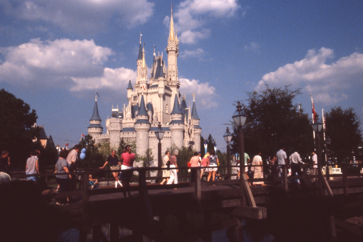 Groups of people on bridge in front of the castle - Walt Disney World, Florida.