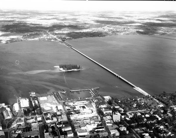Aerial view of Thomas A. Edison memorial bridge over the Caloosahatchee River next to Lofton Island at Fort Myers - Lee County, Florida.