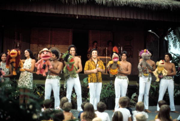 Children watch puppets and performers at the Polynesian Luau - Orlando, Florida .