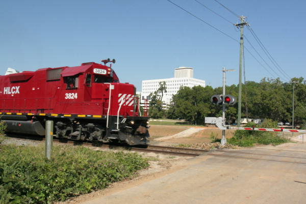 Helm Leasing Company (HLCX) locomotive 3824 traveling through Cascades Park - Tallahassee, Florida.