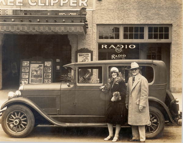 Miss Eva Boswell and Ed A. Crane standing with a Marmon automobile in front of the Capitol Theatre - Jacksonville, Florida.