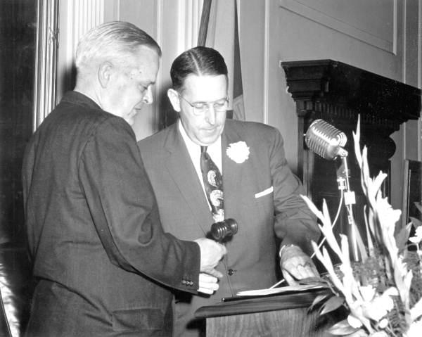 Gavel being passed between Senate President W. Turner Davis of Madison and former President Charley E. Johns of Starke.
