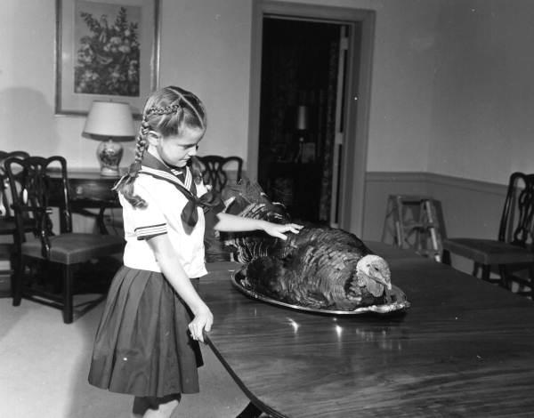 Governor Collins' daughter Darby with Thanksgiving turkey at mansion - Tallahassee, Florida.