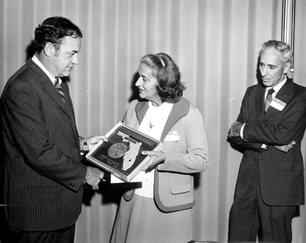 Governor Claude Kirk presenting award to Marjorie Carr while her husband Dr. Archie Carr looks on - Tallahassee, Florida.