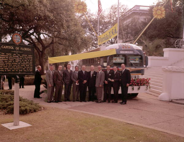 Group portrait of Governor Bryant standing with Florida Development commissioners by bus at the Capitol - Tallahassee, Florida.