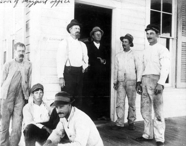 Boatmen with 2 inspectors at the door to office in Mayport, Florida.