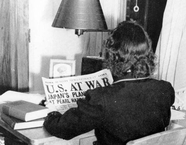 An FSCW student reading newspaper about Pearl Harbor Attack - Tallahassee, Florida.
