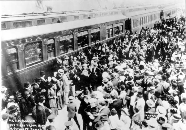 Crowds greet arrival of Henry Flagler and the first train - Key West, Florida.