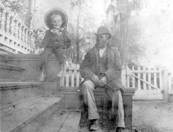 """George Gwynn, Jr. and """"Uncle"""" Liberty sit on the steps - Tallahassee, Florida."""