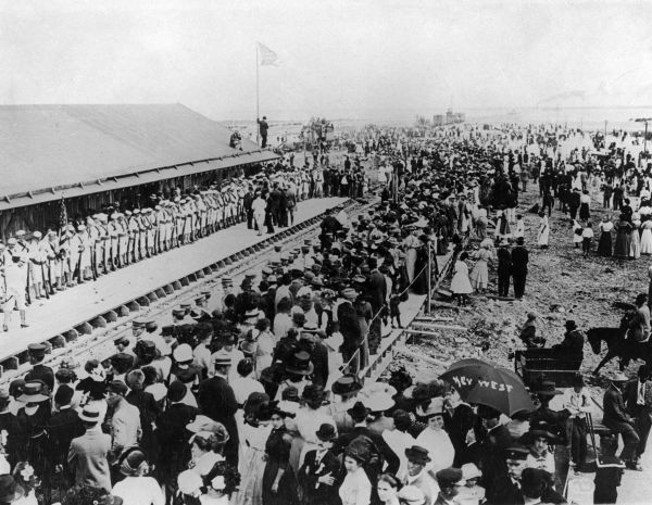 Crowds eagerly awaiting the arrival of the first train - Key West, Florida.