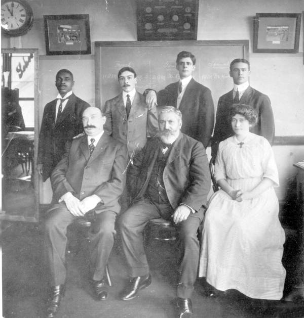 Emile DuBois with others pose for a photo at a room - Tallahassee, Florida