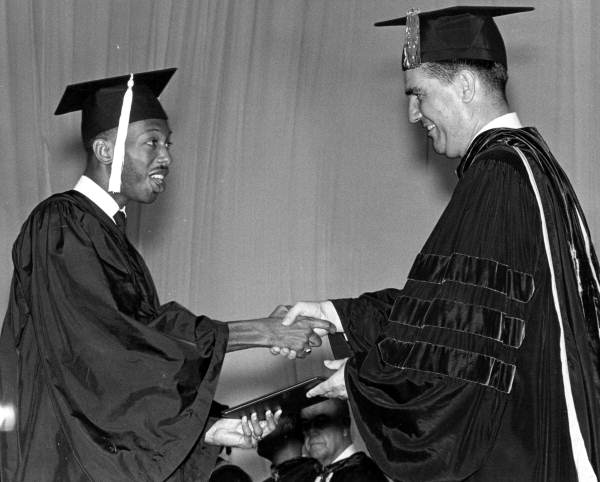 Max Courtney receiving his Bachelor's degree from Florida State University president John E. Champion.