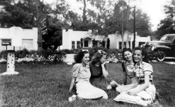 Girls sitting on the lawn together - Tallahassee, Florida.