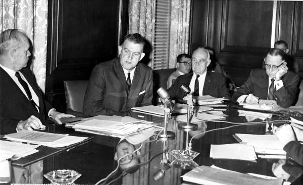 Attorney General James Kynes (2nd left) speaking with Governor Farris Bryant during the first cabinet meeting - Tallahassee, Florida.